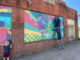 Artwork installed on abandoned buildings.